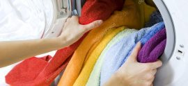 depositphotos_24316013-stock-photo-woman-taking-color-clothes-from
